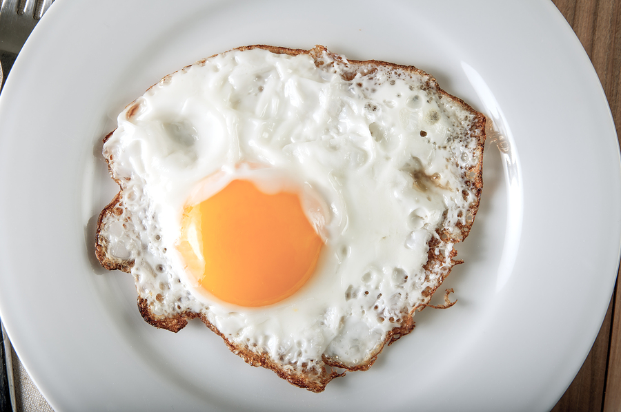 bigstock-Fried-Egg-On-A-Plate-57890216